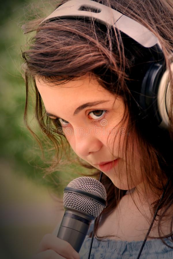 woman singing in microphone royalty free stock images
