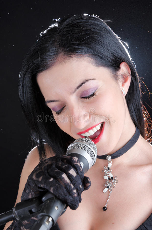 Woman Singing With Microphone royalty free stock photo