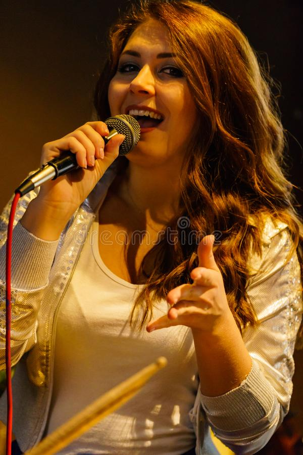Woman singing with microphone stock photos