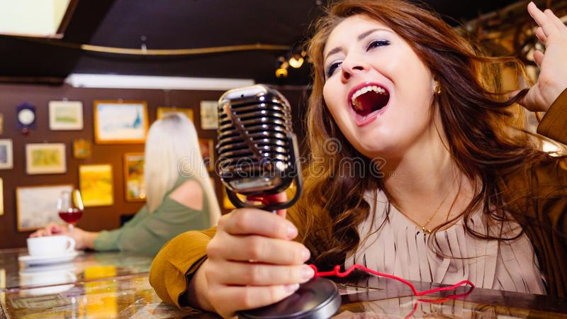 Woman singing with microphone royalty free stock photos