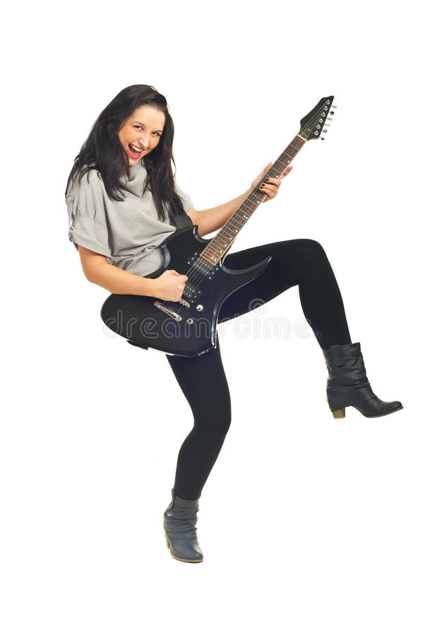 Woman singing and playing guitar royalty free stock images