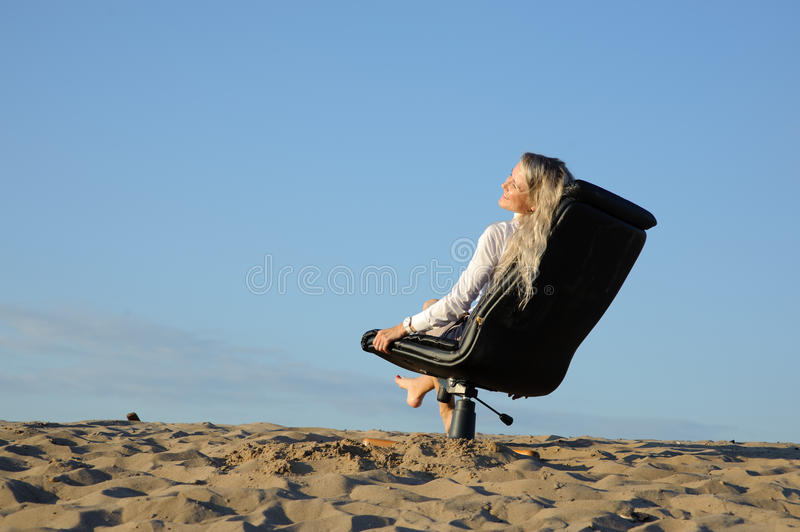 Woman Sit In Armchair Royalty Free Stock Image