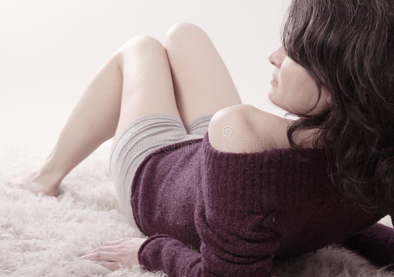 Woman sit on floor stock photo