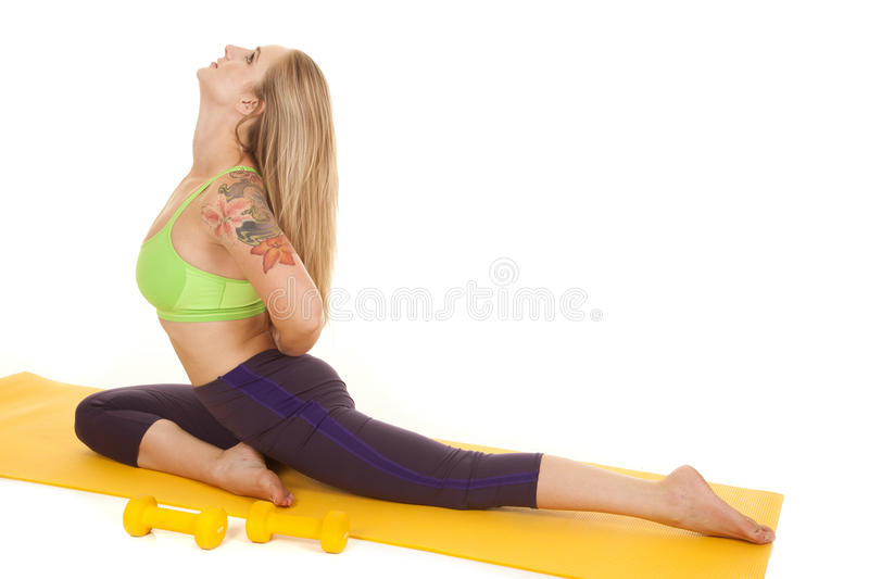 Woman sit green sports bra side head look up royalty free stock images