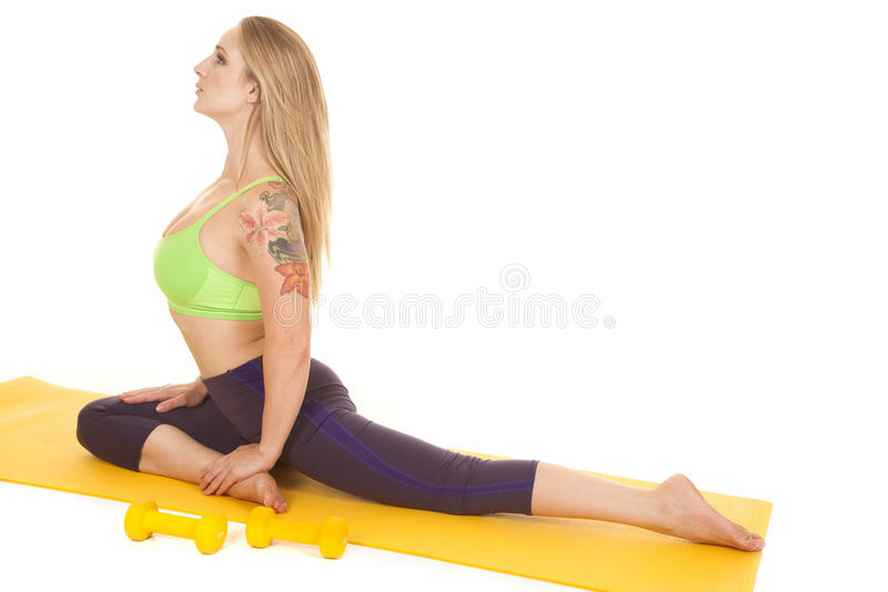 Woman sit green sports bra side stock images