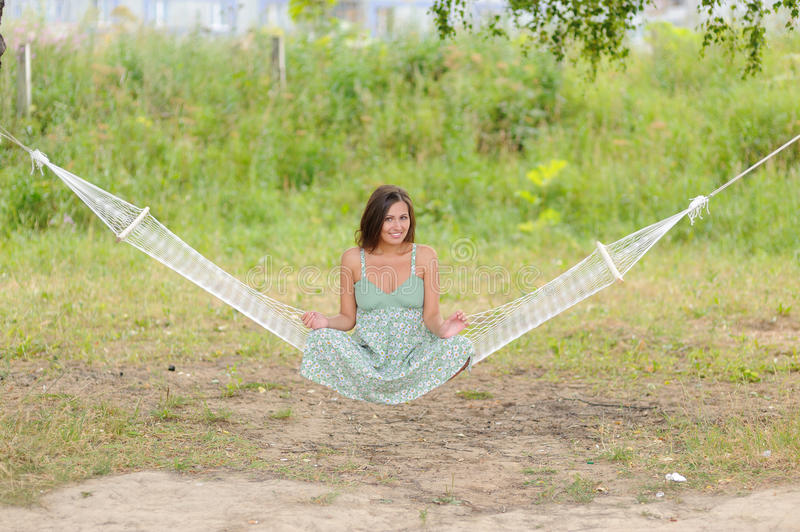 Download Woman Sit On Hammock In The Park Stock Photo - Image: 25556162