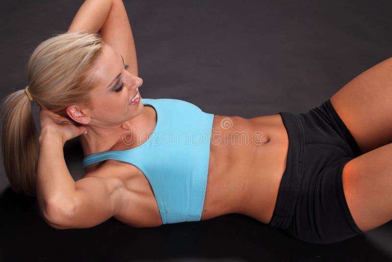 Woman Sit-ups stock photography