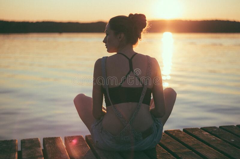 Woman Siting On Dock Near Large Body Of Water Free Public Domain Cc0 Image