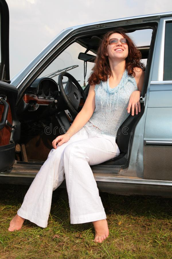 Woman sits in the car
