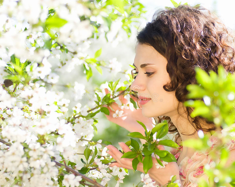 Download Woman Sits On A Chair In A Spring Garden Stock Photos - Image: 24705413