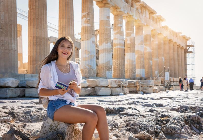 Woman sits in front of the Acropolis of Athens, Greece stock image