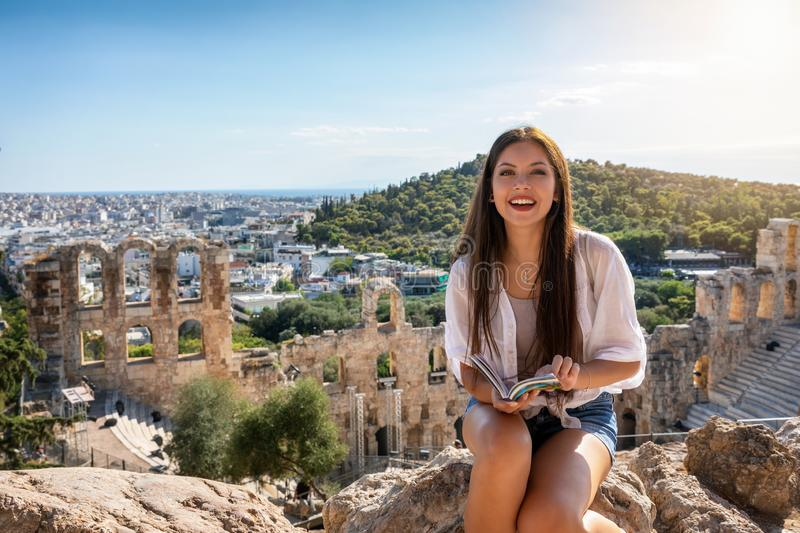 Woman sits in front of the ancient Herodion theater at the Acropolis of Athens, Greece stock images