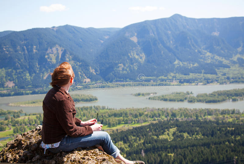 Download Woman Sits At The Top Of A Cliff Stock Image - Image: 25520447