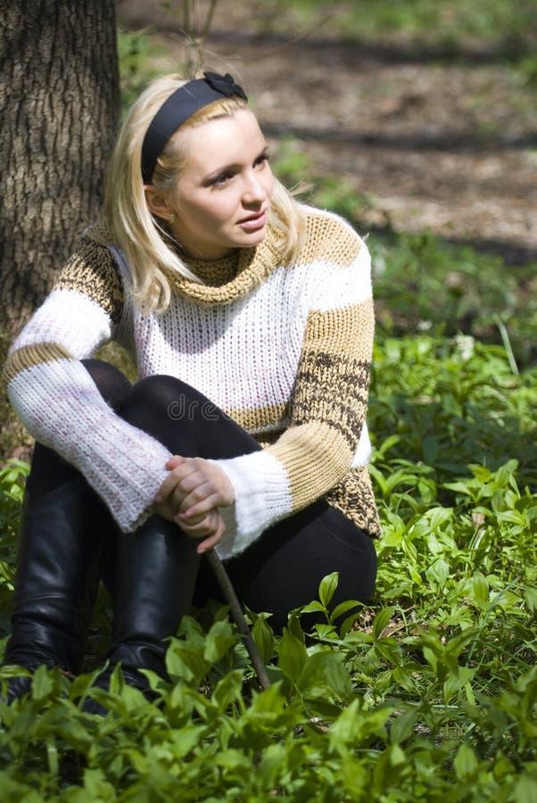 Woman sitting royalty free stock image
