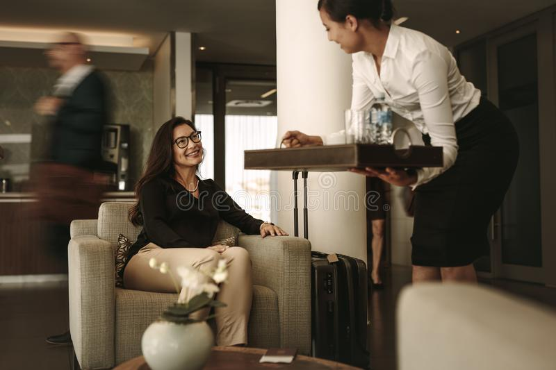 Business traveler at airport waiting lounge stock photography