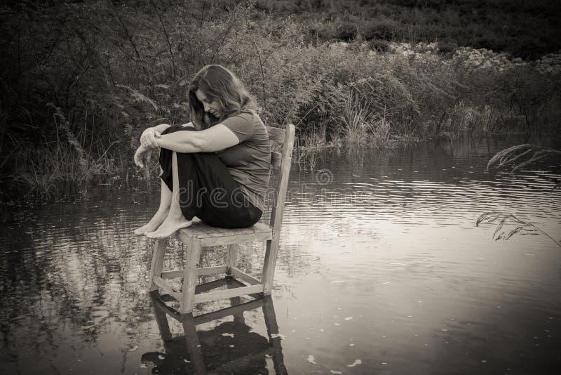 Woman sitting alone royalty free stock photo