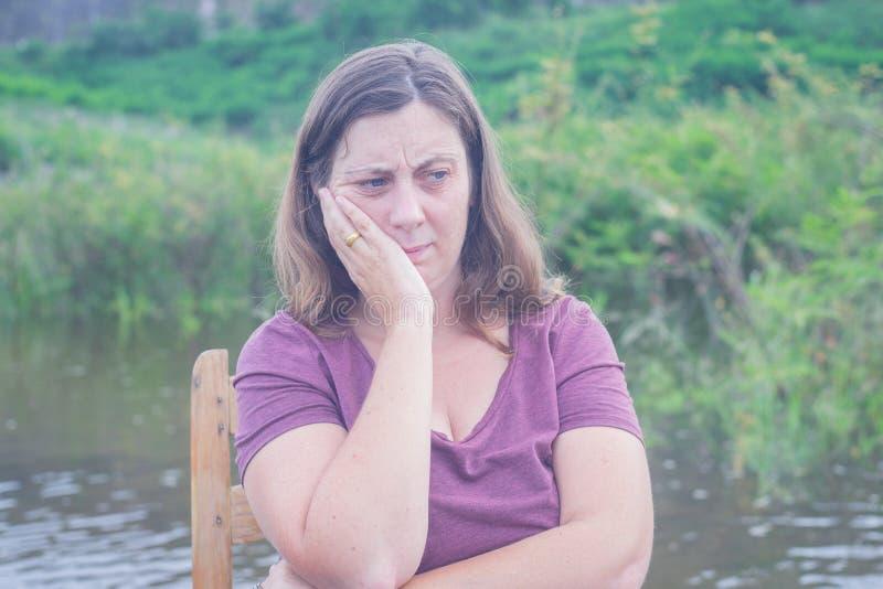 Woman sitting alone royalty free stock image