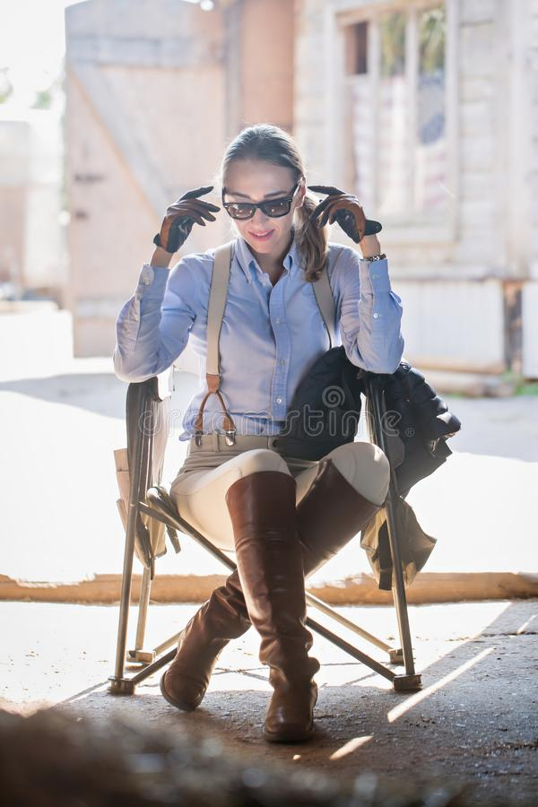 Woman sitting in a chair. stock photography