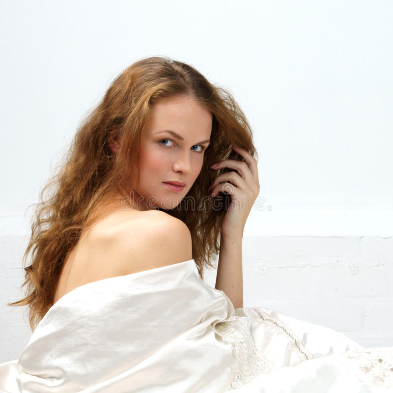 Download Woman Sitting In Bed And Looking At You Stock Photo - Image: 16195458