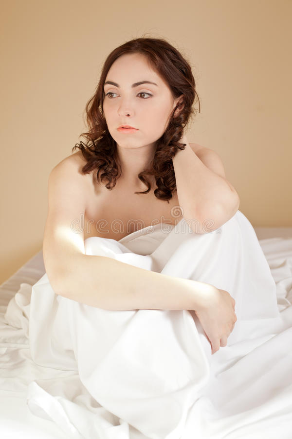 Download Woman Sitting In Bed On The White Bed-clothes Stock Image - Image: 21601775