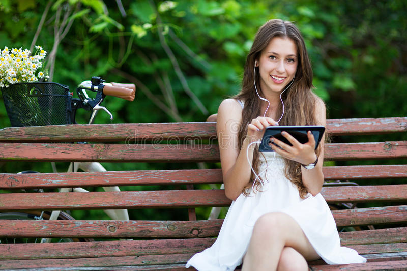 Download Woman Sitting On Bench With Digital Tablet Stock Image - Image: 25693883