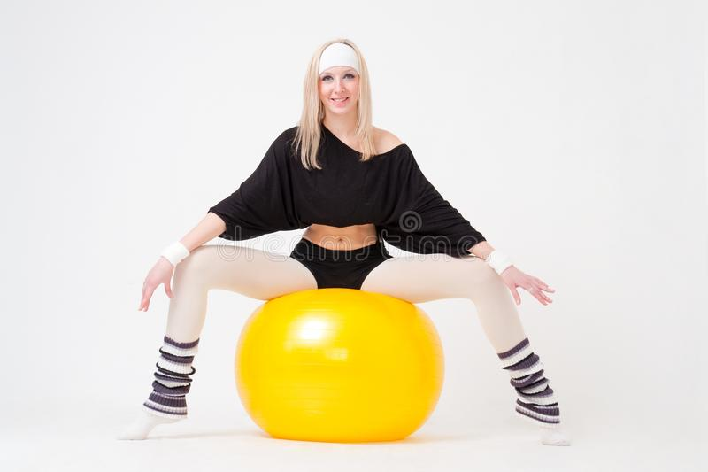 Download Woman Sitting On A Big Fitness Ball Stock Photo - Image: 13140010
