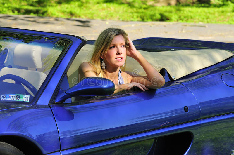 Woman sitting in a car royalty free stock photo