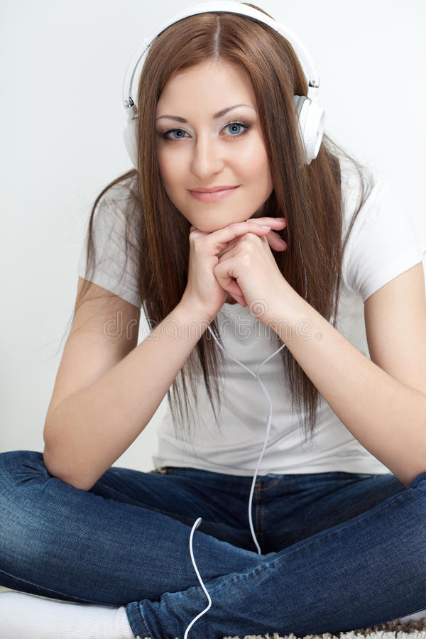 Download Woman Sitting On Carpet And Listen To The Music Stock Photo - Image of home, happy: 28020296