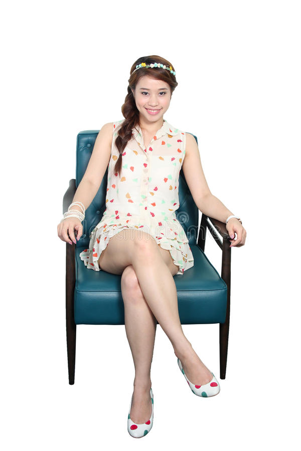 Woman sitting on a chair royalty free stock photos