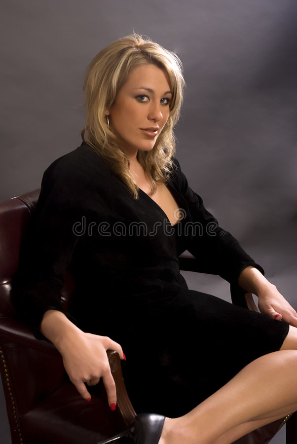 Woman sitting in chair royalty free stock photos