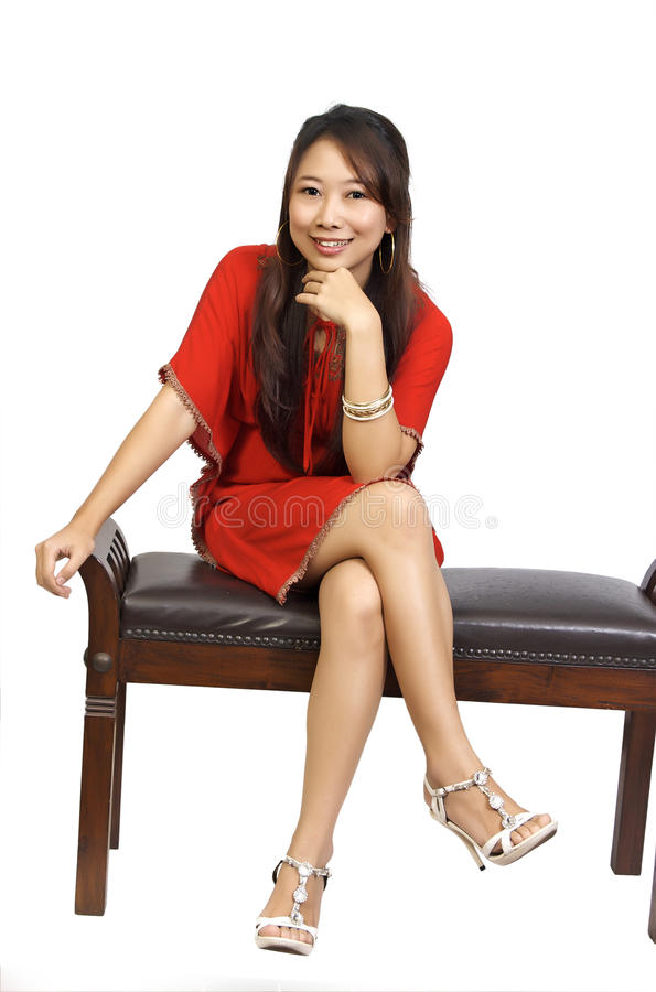 Woman Sitting On Chair Wearing Red Dress Royalty Free Stock Images