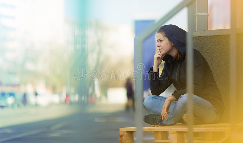 Woman sitting in city - street photo stock photography