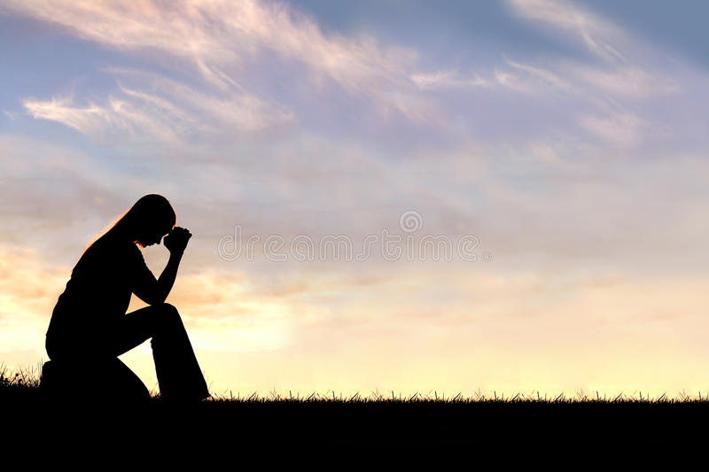 Woman Sitting Down in Prayer Silhouette royalty free stock image