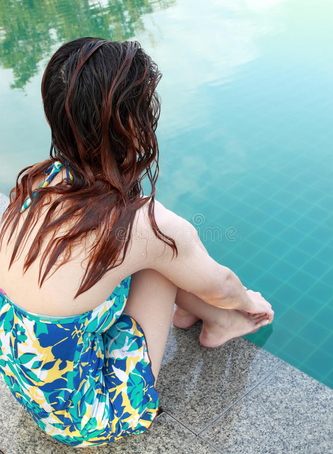 Download Woman Sitting At The Edge Of Swimming Pool Stock Image - Image: 26327333