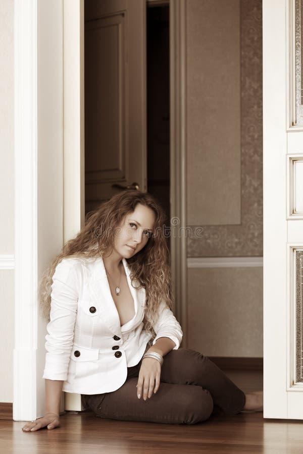 Download Woman sitting on the floor stock image. Image of door - 25738117