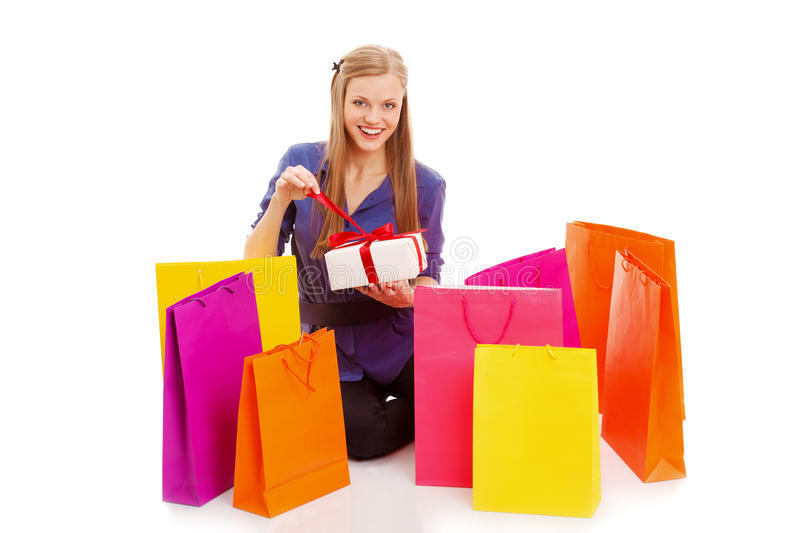 Download Woman Sitting On The Floor Behind Shopping Bags Stock Photo - Image: 29216804