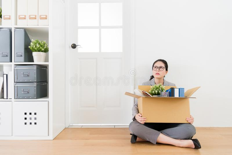 Woman sitting on the floor carrying her things royalty free stock photo