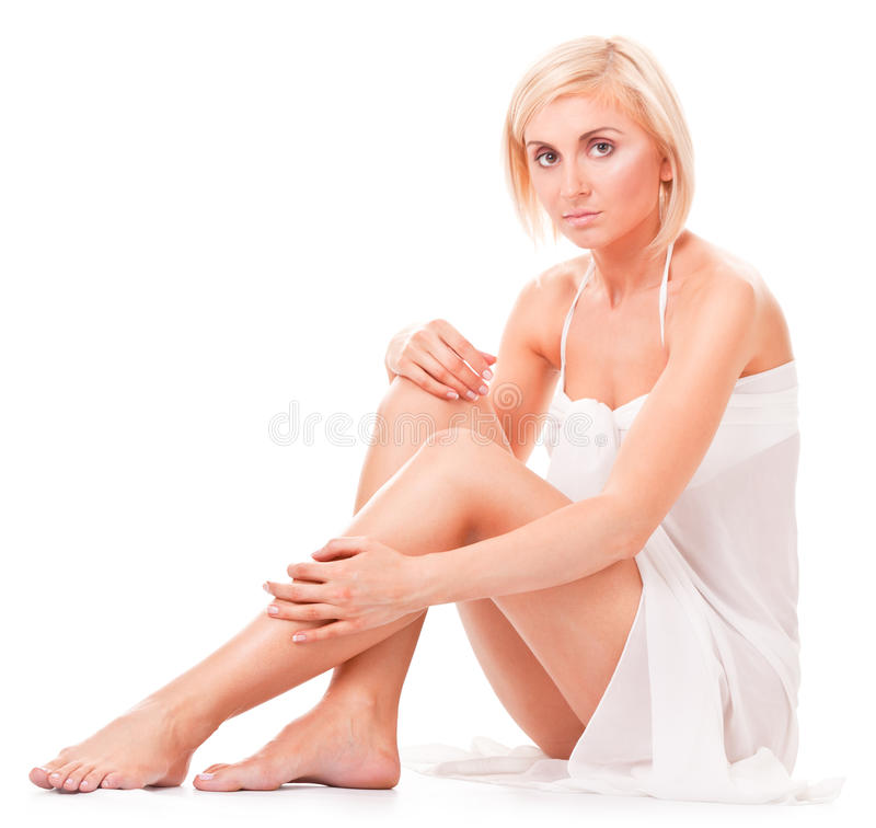Woman Sitting On The Floor, Showing Her Slim Legs Stock Image