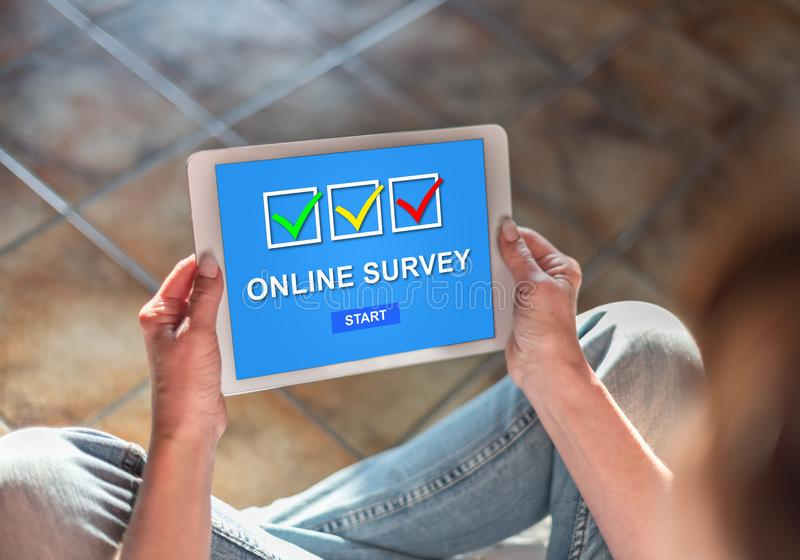 Online survey concept on a tablet royalty free stock image
