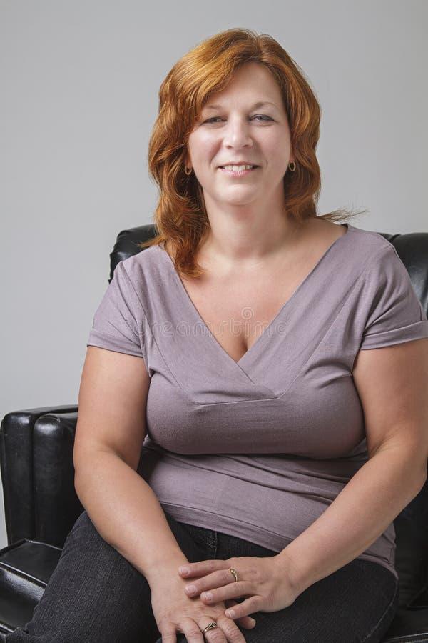 Woman sitting stock photo