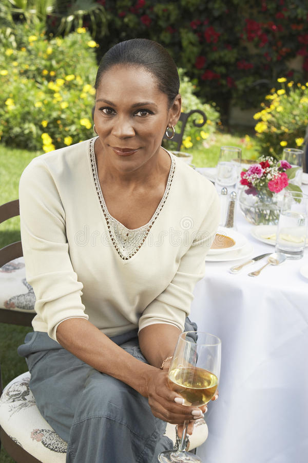 Woman Sitting With A Glass Of Wine royalty free stock images