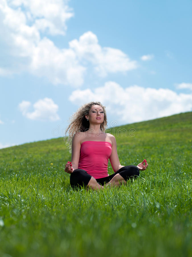 Woman sitting on the grass royalty free stock photos