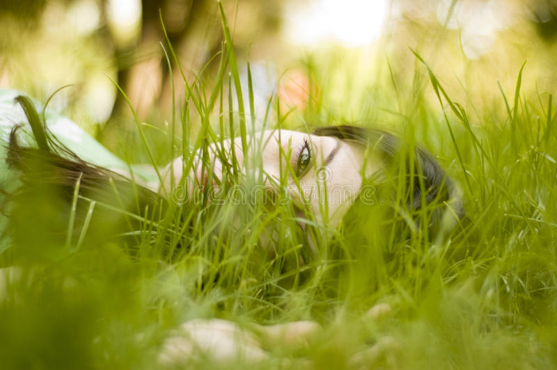 Download Woman Sitting In Grass Stock Photo - Image: 41924293