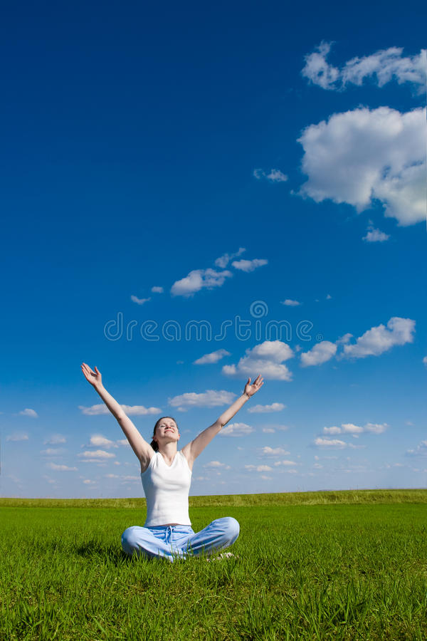 Download Woman Sitting On Green Grass Stock Photo - Image: 9690878