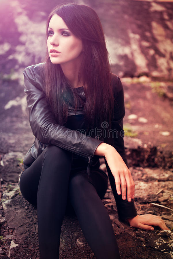 Woman sitting on the ground stock photography