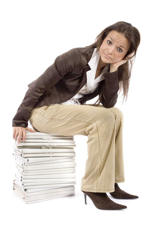 Woman sitting on the heap of files stock images