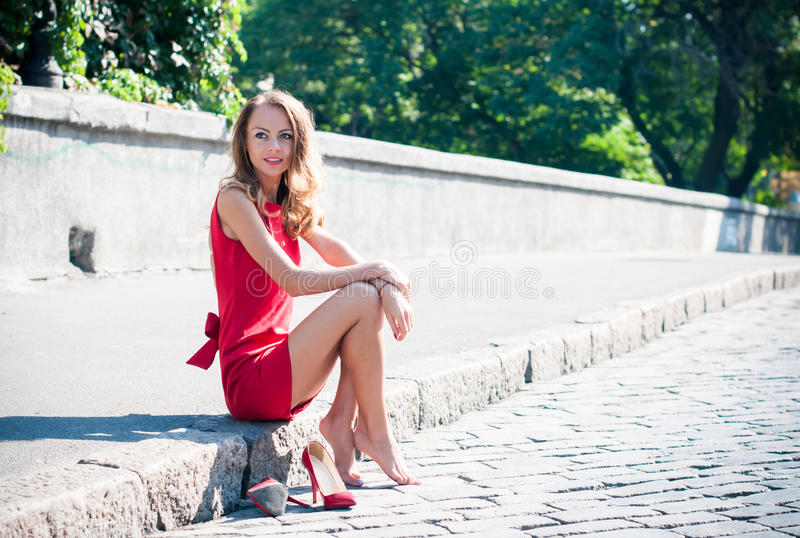 De rojo intenso. - Página 5 Woman-sitting-her-shoes-beautiful-young-slim-empty-city-street-lady-red-dress-high-heels-has-fun-44613225