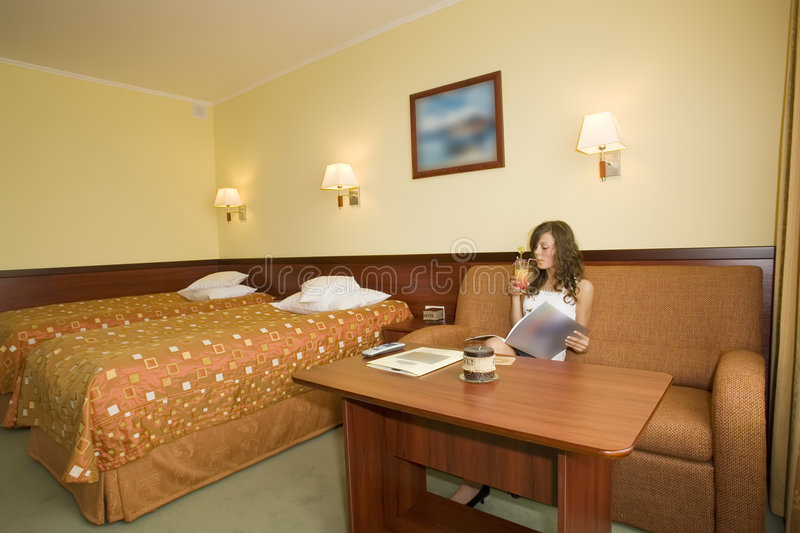 Woman sitting in hotel room stock images
