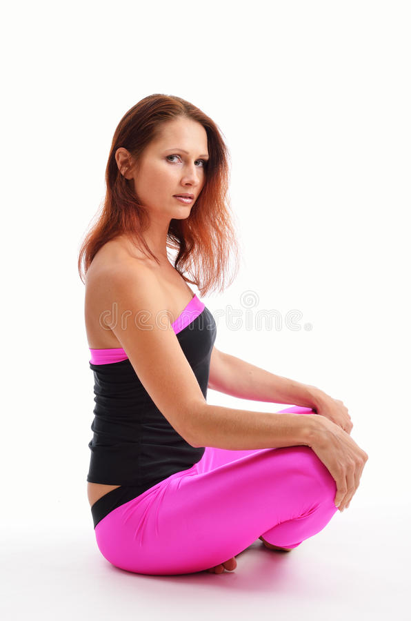 Woman sitting in the lotus position stock image