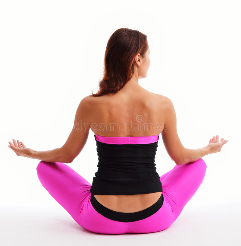 Woman sitting in the lotus position royalty free stock image